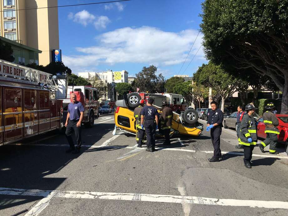 A rollover crash resulted in one minor injury and blocked traffic at Van Ness Avenue and Greenwich Street Tuesday afternoon, officials said. Photo: San Francisco Fire Department / /