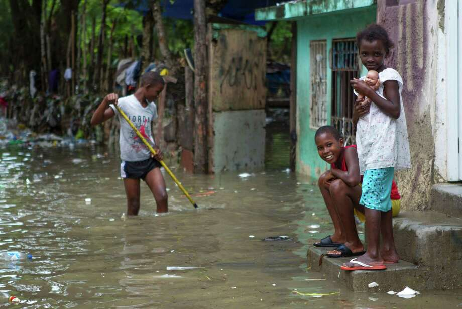 Hispaniola - the island shared by the Dominican Republic and Haiti - felt the effects of Hurricane Matthew on Tuesday, as the storm's surge flooded the neighborhood of La Puya in Santo Domingo. Photo: ERIKA SANTELICES, Stringer / AFP of licensors