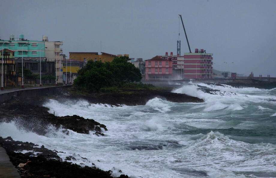 Waves crash against a seawall in Baracoa, Cuba, Tuesday, Oct. 4, 2016, before the arrival of Hurricane Matthew. The storm was moving along the Windward Passage between Haiti and Jamaica headed for southeastern Cuba and then the Bahamas. (AP Photo/Ramon Espinosa) Photo: Ramon Espinosa, STF / Copyright 2016 The Associated Press. All rights reserved.