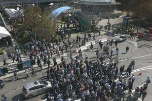 Scores of Dreamforce conference-goers converge on Fourth and Howard streets for the weeklong event hosted by Salesforce at the Moscone Convention Center in San Francisco, Calif. on Tuesday, Oct. 4, 2016.