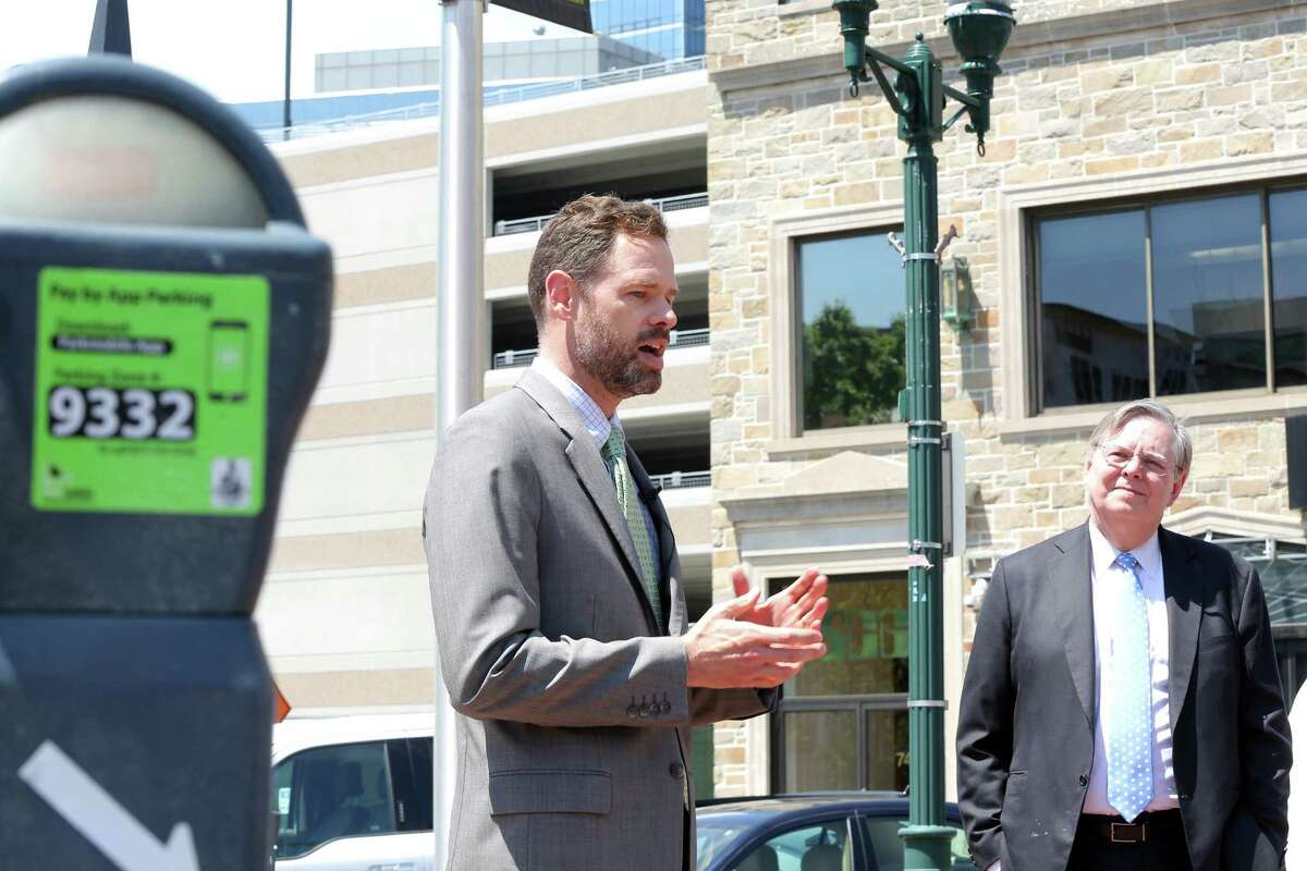 Stamford Bureau Chief of Transportation, Traffic & Parking Josh Benson discusses the new app Parkmobile, which the city of Stamford has implemented to make paying for parking easier, during an outdoor press conference in May.