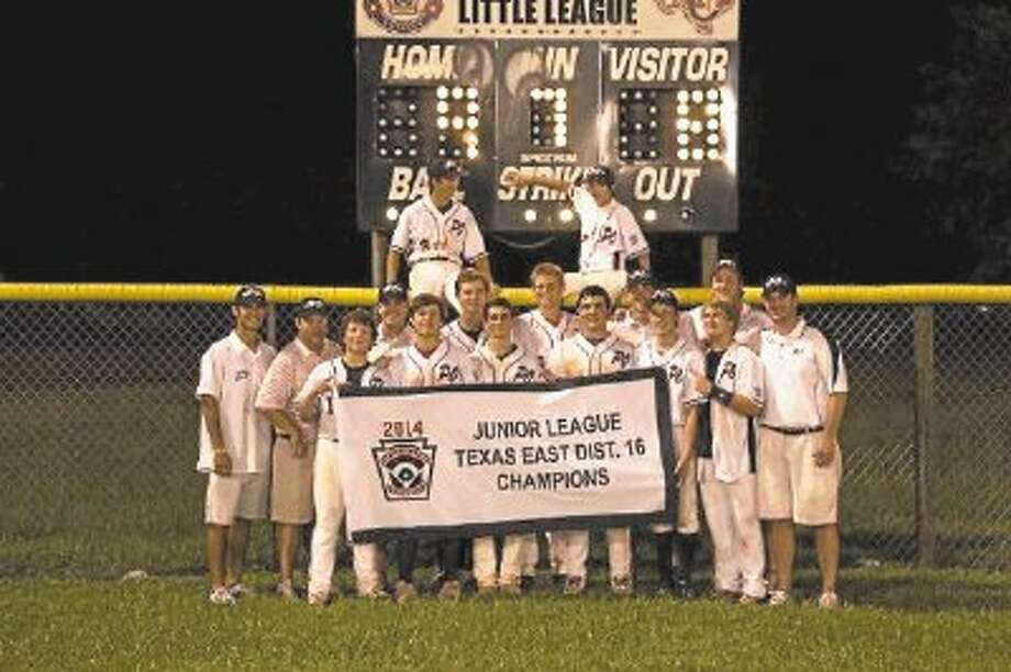 Submitted Photo The Post Oak Juniors Little League hold their Texas East District 16 banner moments after they knocked off West University 9-8 to advance to last week's Section 3 tournament. The Juniors also were winners there and will now go to the Texas Little League state tournament in Tyler where they will begin play this Saturday night. Going into Tyler, the team was 5-0 in their first two tournaments and a championship in Tyler would move them to the Southwest Regionals next week. The Juniors hold their world series in the middle of August in Michigan and the game is nationally televised on one of the ESPN channels. / @WireImgId=2682649