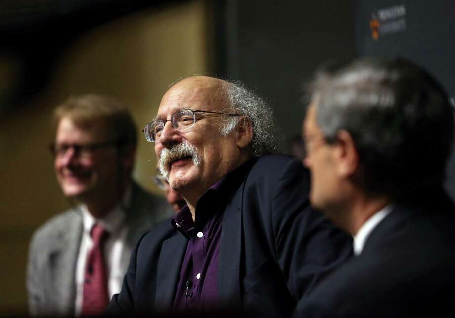 F. Duncan Haldane, center, addresses a gathering Tuesday at Princeton University after the announcement that he and two colleagues, David J. Thouless and J. Michael Kosterlitz, have been awarded the 2016 Nobel Prize in Physics Photo: Mel Evans, STF / Copyright 2016 The Associated Press. All rights reserved.