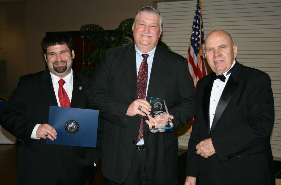 Mike Penry is the Citizen of the Year for the Greater Cleveland Chamber of Commerce. Penry (center) is vice president of First Bank and Trust and serves on the Cleveland City Council and with the Cleveland Lions Club. The award was presented at the chamber's gala on Friday, Feb. 19, by Jim Carson, chief operating officer for the chamber, and Will Carter with Congressman Brian Babin's office (left). Photo: Vanesa Brashier
