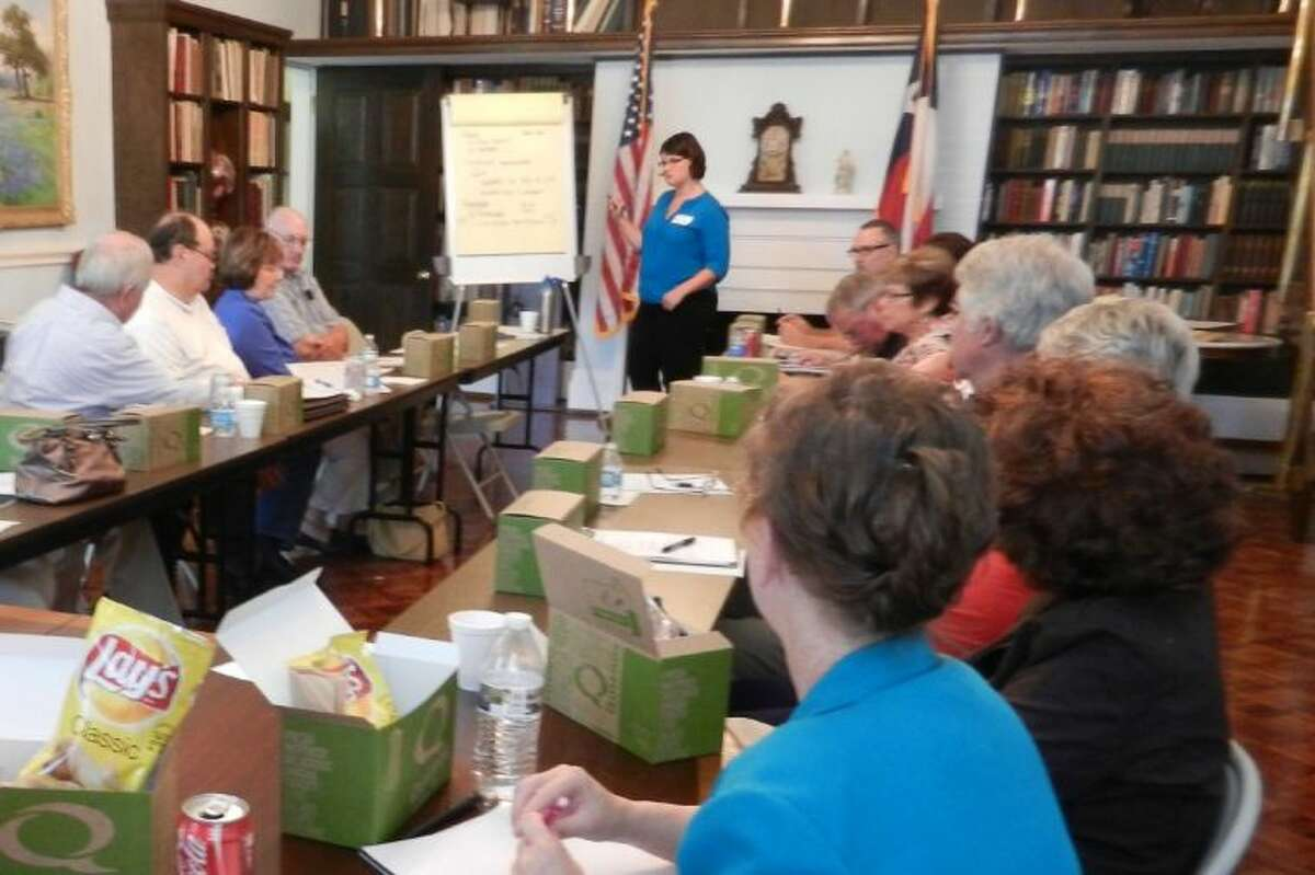 Exhibit planner Erin McClelland leads a focus group discussion of topics for the new exhibit at the Sam Houston Center in Liberty.