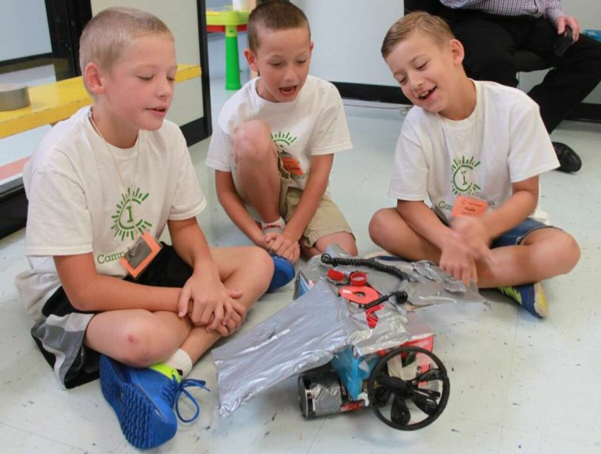 Carson Williams, Blain Thornton and Kade Jordan show off their flying car. While the project couldn't actually fly, the vehicle was a prototype of one the boys hope to see one day in the future. It was one of their projects at Camp Invention, held at San Jacinto Elementary in Liberty during the week of July 7-11.