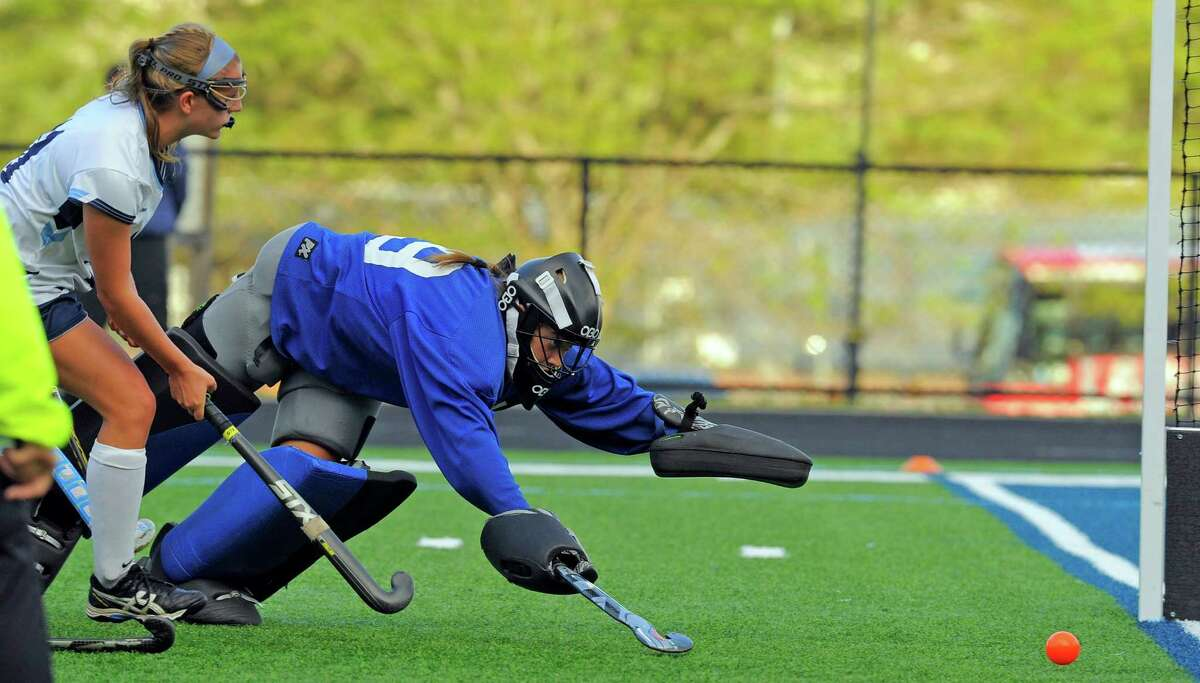 Wilton's Delaney Chase follows her shot against Darien goalie Kallie Coughlin during the second half of the Warriors' 3-1 victory on Tuesday in Wilton.