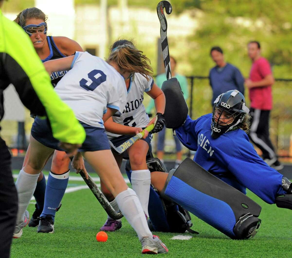 Darien goalie Kallie Coughlin attempts to block the secon-half goal of Wilton's Delaney Chase during the Warriors' 3-1 victory on Tuesday in Wilton.