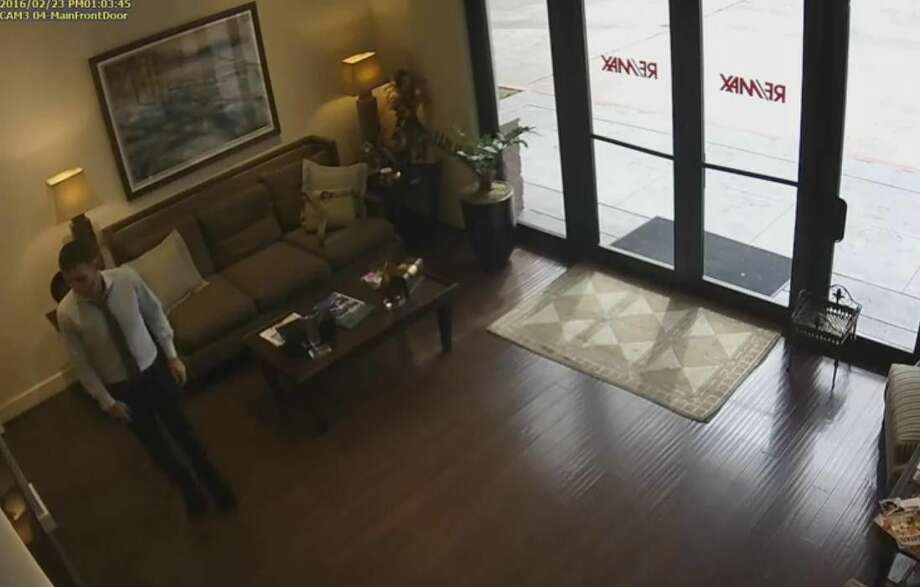 A Woodlands real estate agency is hoping video surveillance footage can capture a man who entered the business and stole one realtor's wallet and a receptionist's purse.