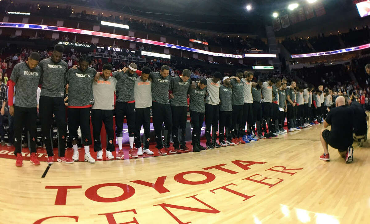 Rockets and Knicks players locked arms in a show of unity during the national anthem before Tuesday's preseason game at Toyota Center. (Photo via Houston Rockets Twitter account)