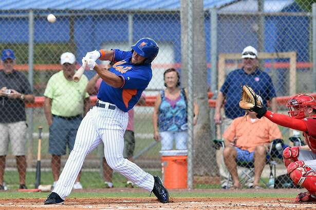 Tim Tebow hits solo home run in his first at bat during the first inning of  his first instructional league baseball game for the New York Mets against the St. Louis Cardinals instructional club Wednesday, Sept. 28, 2016, in Port St. Lucie, Fla. (Jeremiah Wilson/The Stuart News via AP)
