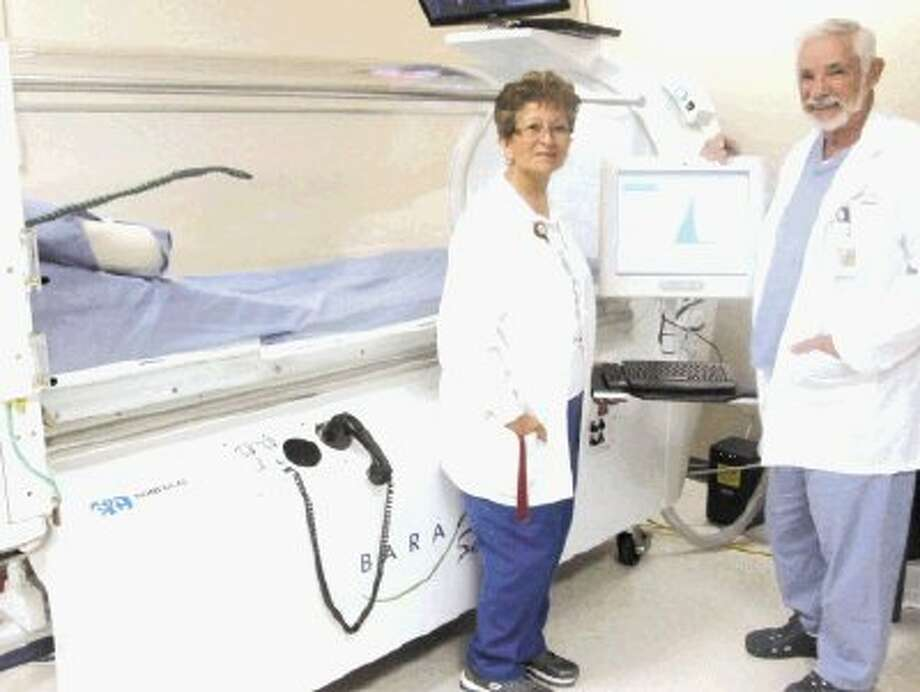 """""""Hyperbaric oxygen therapy plays an important role in wound healing,"""" said Wound Care medical director Donald Sprague, M.D. with clinical manager Marty Kennedy. A third hyperbaric chamber will be added in the near future to the hospital's wound care program."""