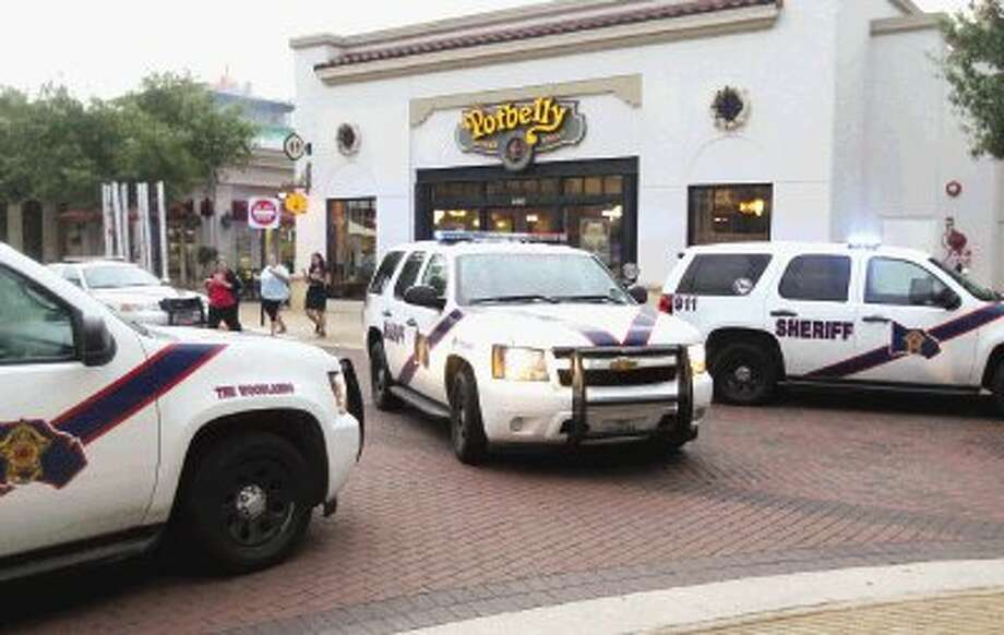 Montgomery County Sheriff's Office vehicles and investigators were at Thomas Markle Jewelers in Market Street Thursday evening after witnesses said three men came in and robbed merchandise from the glass cases. The three men fled in a small car and led deputies on long chase back to Houston where the men were arrested. Photo: Jason Fochtman