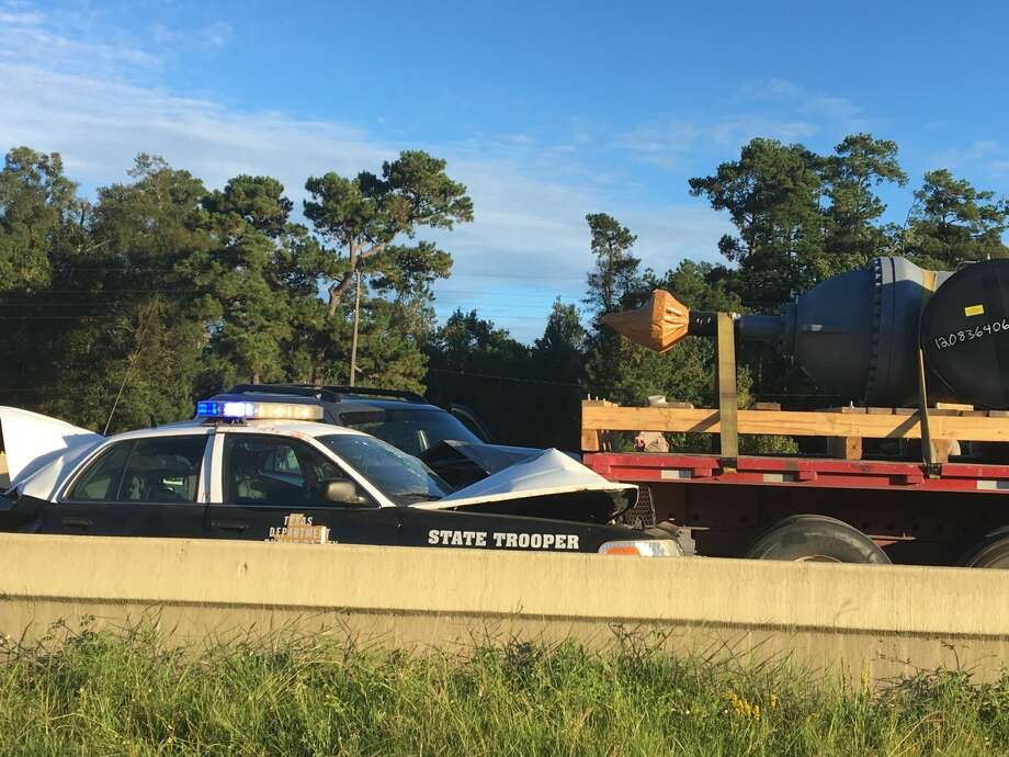The Texas Department of Public Safety is investigating a Wednesday crash involving a Texas State Trooper. The trooper, was assisting an 18-wheeler stalled in the shoulder when his vehicle was struck from behind by a Ford Ranger. Photo: Sara E. Flores/ The Enterprise