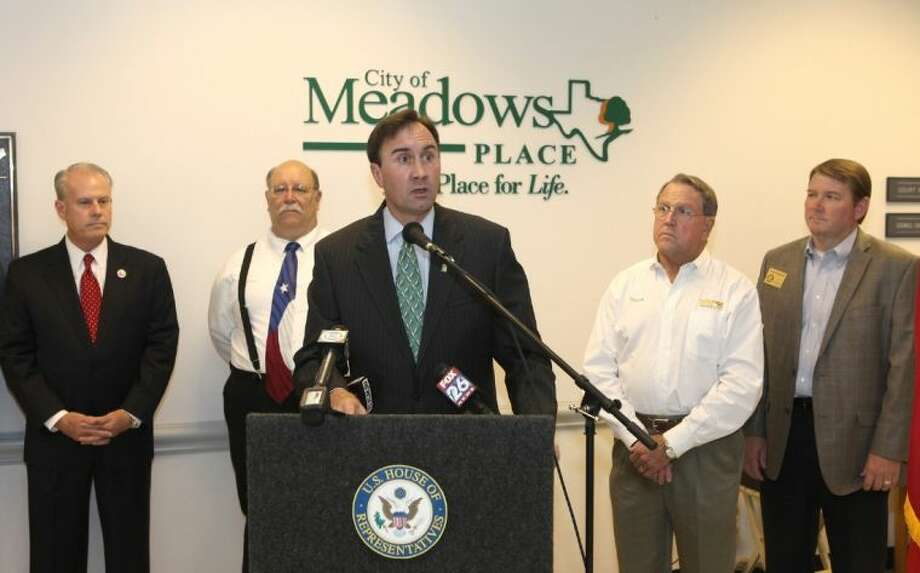 "Congressman Pete Olson speaks along with local mayors to announce ""Our Communities, Our Choice Act"" legislation during a press conference at Meadows Place City Hall on Friday, July 18. Standing behind Olson is (L to R) Rosenberg Mayor Vincent Morales, Meadows Place Mayor Charles Jessup, Missouri City Mayor Allen Owen and Fulshear Mayor Tommy Kuykendall. Photo: Alan Warren"