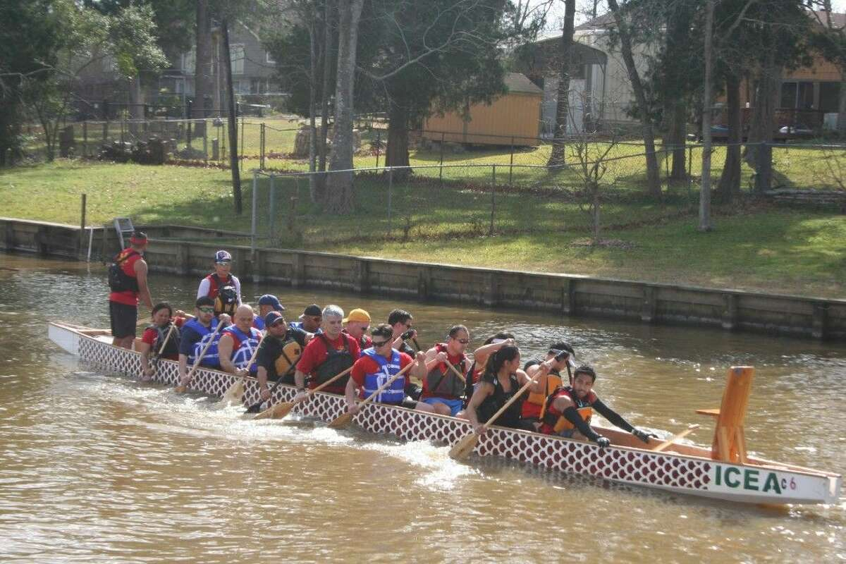 During one of the training courses, paddlers learn how to properly paddle to propel their Dragon Boat in a cove on Lake Houston Saturday, Feb. 20, 2016.