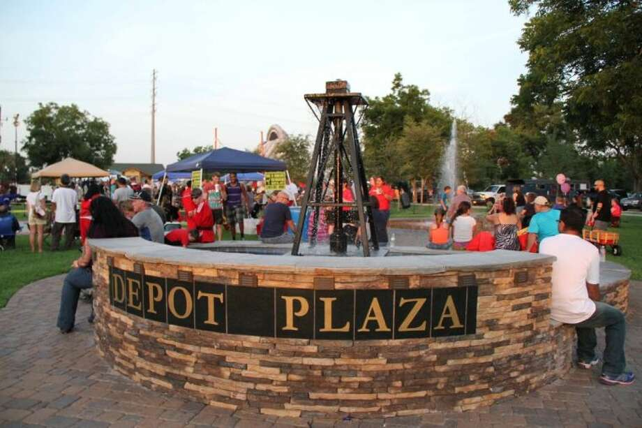 People gather around the Depot Plaza during last year's Tomball Night. This annual event is set for Aug. 1 from 5-10 p.m. all around Tomball. Photo: File Photo