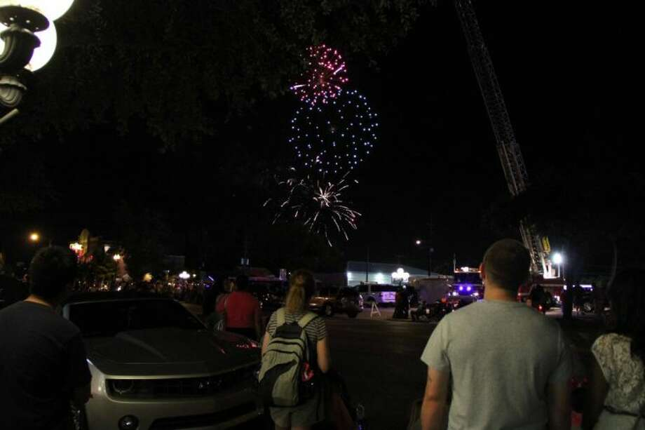 People enjoy fireworks and the conclusion of Tomball Night. This annual event is set for Aug. 1 from 5-10 p.m. all around Tomball. Photo: File Photo