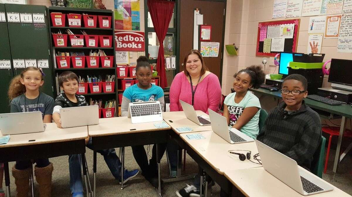 Students in Kelleen Todd's fourth grade RELA class at Humble Elementary are excited to use the new Chromebook Flips. Pictured from left are Brooklynn Parsons, Jack Robinson, Adrieyuanna Jones, Kelleen Todd, Brionna Smith and Avonte Jones.