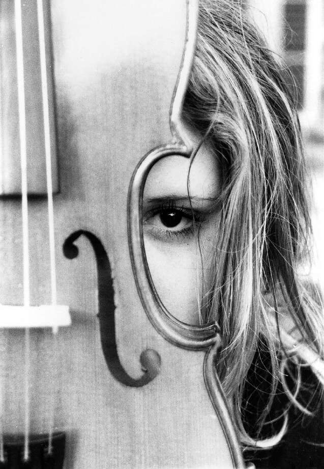Cypress Creek High School sophomore Melody Ballinger's photography entry, The Girl Behind the Violin, won a Scholastic Art regional Gold Key award and was selected by the Museum of Fine Arts Houston to be on display through March 7. Photo: Submitted Photo