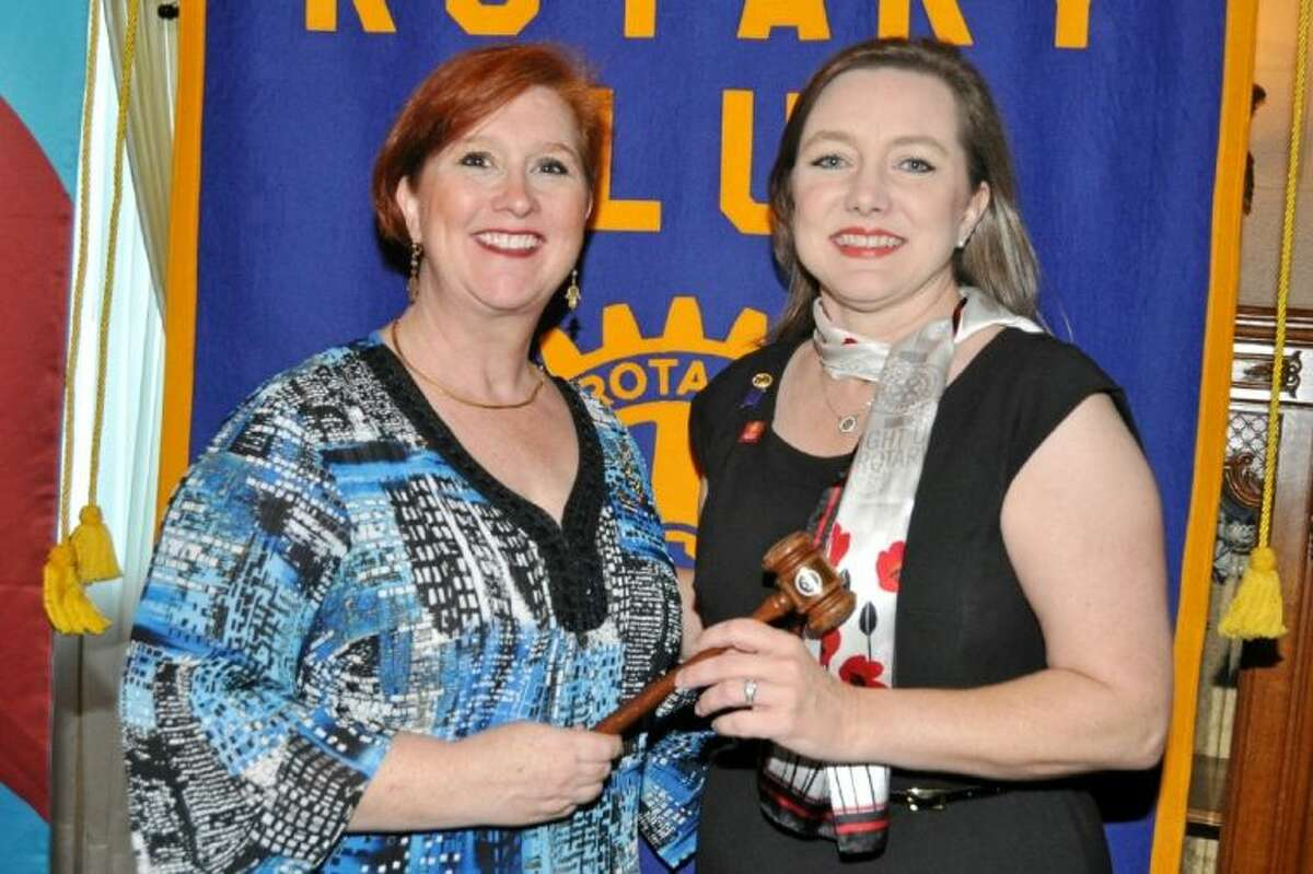 Outgoing President Dana Philibert (l) passes the office of Club President and the gavel to newly installed President Niki Whiteside. President Whiteside takes the helm of Pasadena's oldest service club as it begins its 78th year.