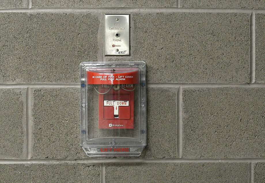 A fire alarm is seen on the wall in a hallway at the SEFCU arena at University at Albany on Tuesday, Oct. 4, 2016 in Albany, N.Y. The city of Albany is looking to fine alarm system companies that are repeat offenders of false alarms at buildings in the city. (Lori Van Buren / Times Union) Photo: Lori Van Buren / 40038263A