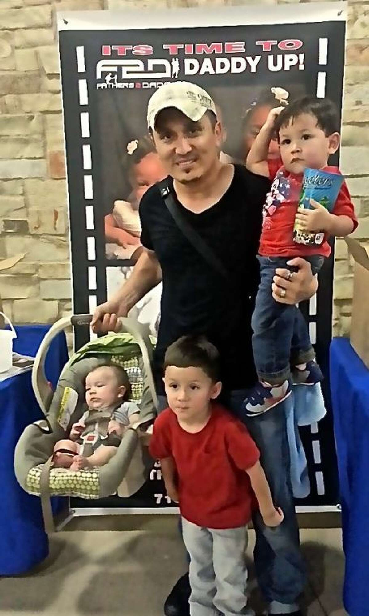 A local father with his sons at previous Fathers 2 Dads event.