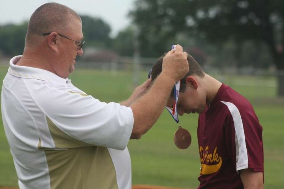 Infielder Caleb Bills receives his South Zone medal from tournament director Billy Brooks after last Saturday's loss to Friendswood. Photo: Robert Avery Photos