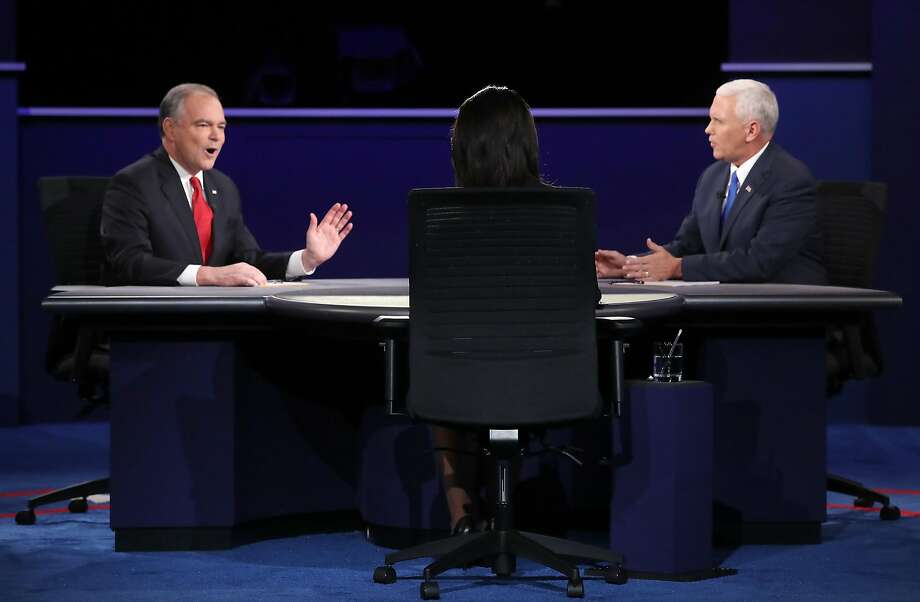 Democratic vice presidential nominee Tim Kaine (L) and Republican vice presidential nominee Mike Pence (R) speak as debate moderator Elaine Quijano (C) listens during the Vice Presidential Debate at Longwood University on October 4, 2016 in Farmville, Virginia.  This is the second of four debates during the presidential election season and the only debate between the vice presidential candidates.  Photo: Mark Wilson, Getty Images
