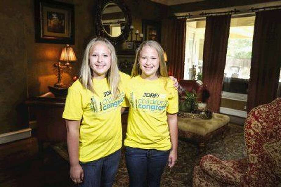 From left, Jillian and Jacquelyn Johnson pose for a portrait together Monday at their home in The Woodlands. The Johnson twins, both diagnosed with Type 1 diabetes, were chosen to represent the Juvenile Diabetes Research Foundation at the Children's Congress in Washington, D.C., July 13-15. Photo: Michael Minasi