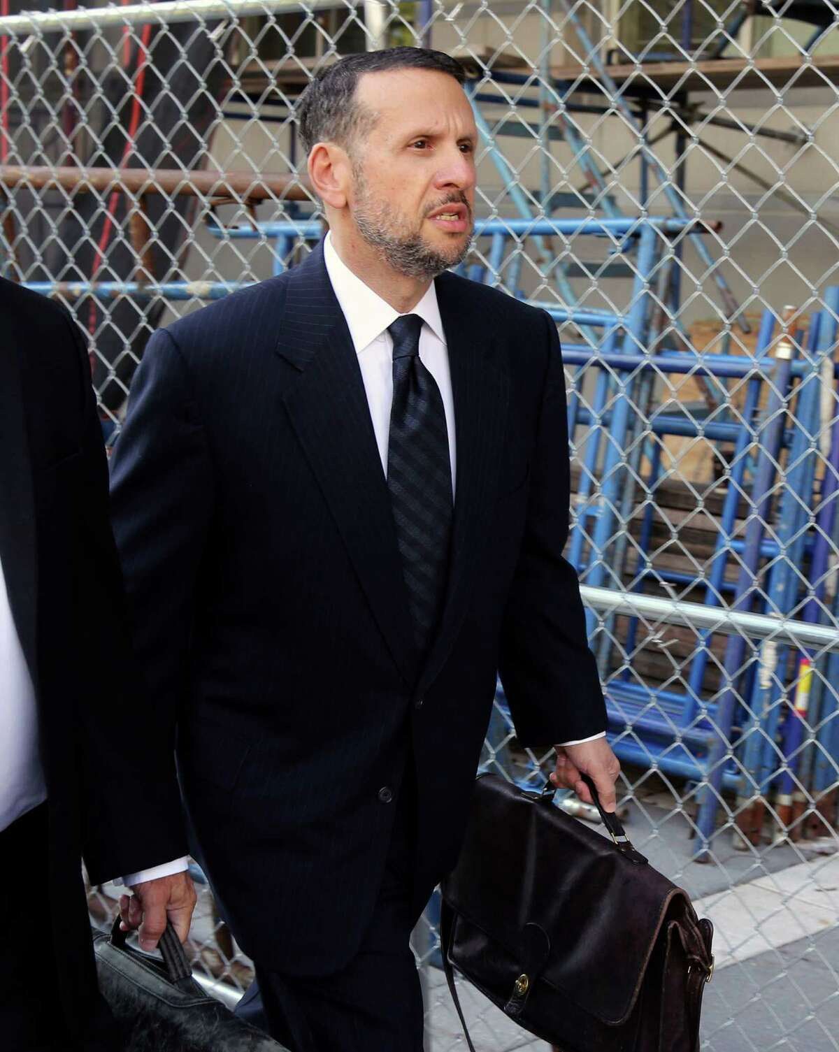 FILE - In a Friday, Sept. 23, 2016 file photo, David Wildstein arrives at the federal courthouse, in Newark, N.J. Wildstein testified Tuesday, Oct. 4, 2016, that New Jersey Gov. Chris Christie and New York Gov. Andrew Cuomo discussed releasing a false report to tamp down questions over the George Washington Bridge lane-closure scandal. (Chris Pedota/The Record via AP, File) ORG XMIT: NJHAC501