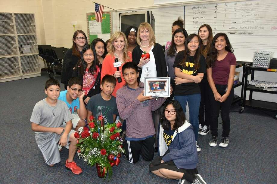 Kahla Middle School sixth-grade math teacher Camille Bunker Ramirez's students join her and KHOU Great Day Houston correspondent Courtney Perna after she won the Star Furniture Red Apple Award for May 2015 on May 28.
