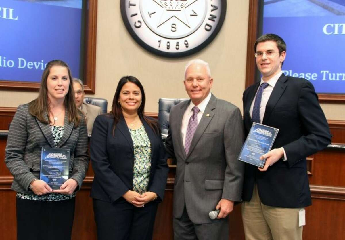 Pictured (left to right) during a recent Sugar Land City Council recognition ceremony are Assistant Public Works Director Dawn Steph, Texas Public Works Association Southeast Branch President Andrea Brinkley, Mayor James Thompson and Environmental Manager Gabe Reaume.