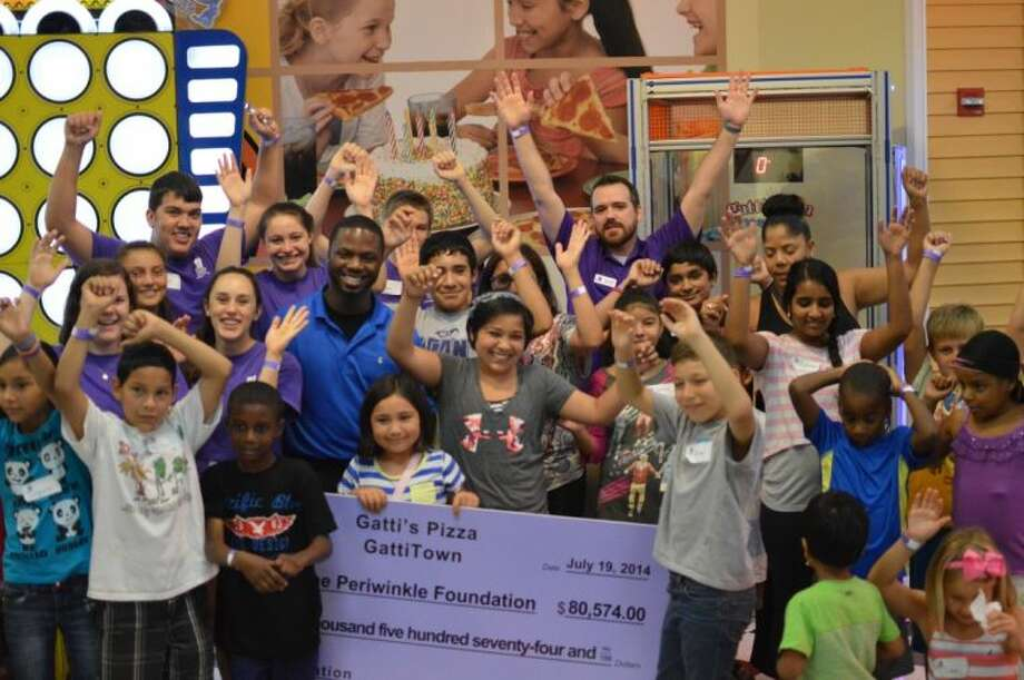 GattiTown Sugar Land presents a check for more than $80,000 to The Periwinkle Foundation. Photo: Submitted Photo