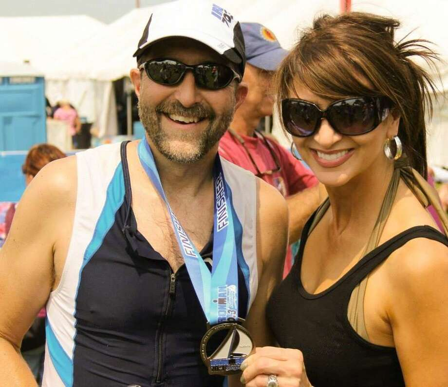 Bill and Valerie Quella celebrate after Bill completed a half-Ironman in Wisconsin in 2014.