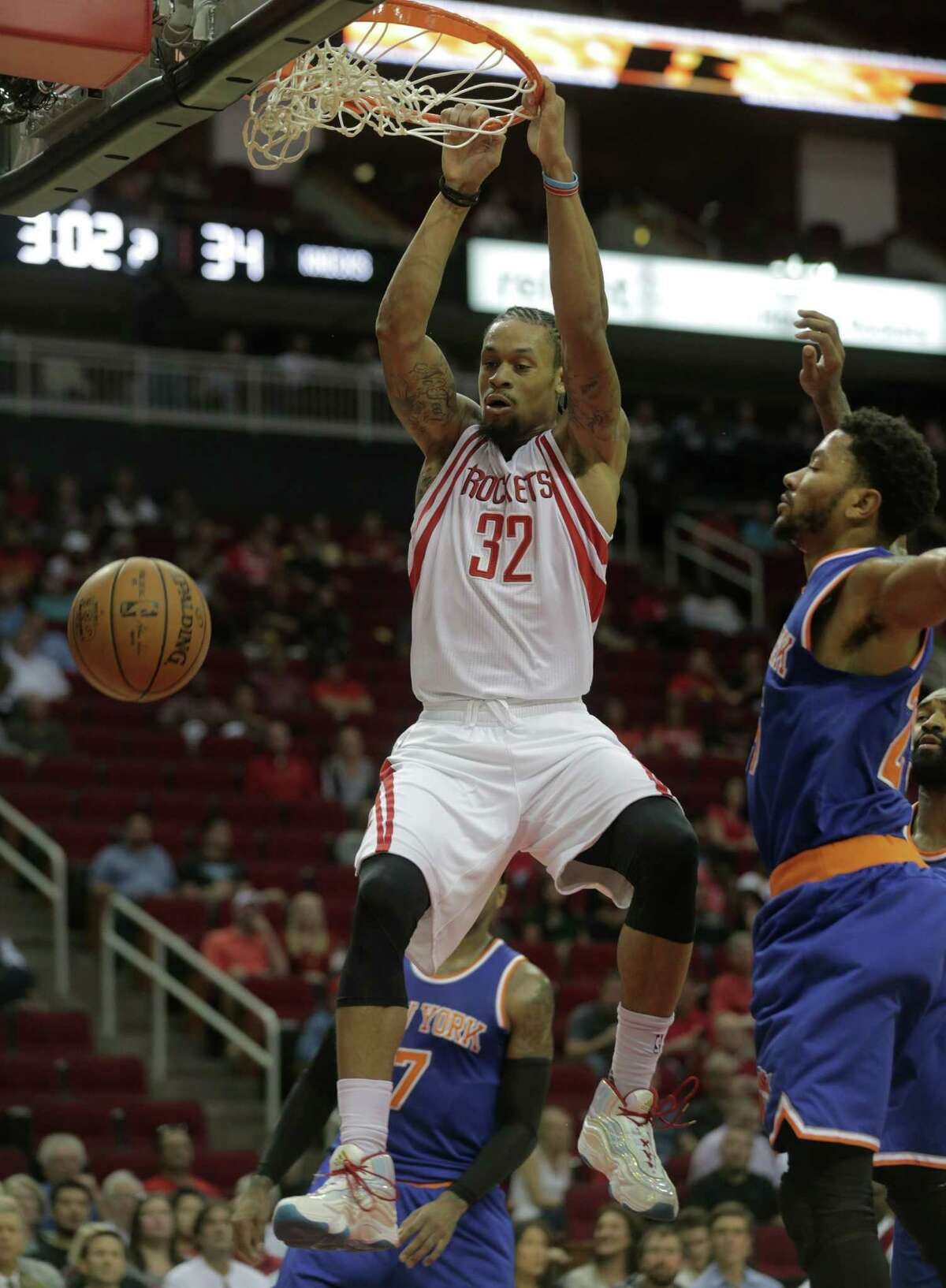 Houston Rockets guard K.J. McDaniels (32) dunks the ball against the New York Knicks at the Toyota Center on Tuesday, Oct. 4, 2016, in Houston.