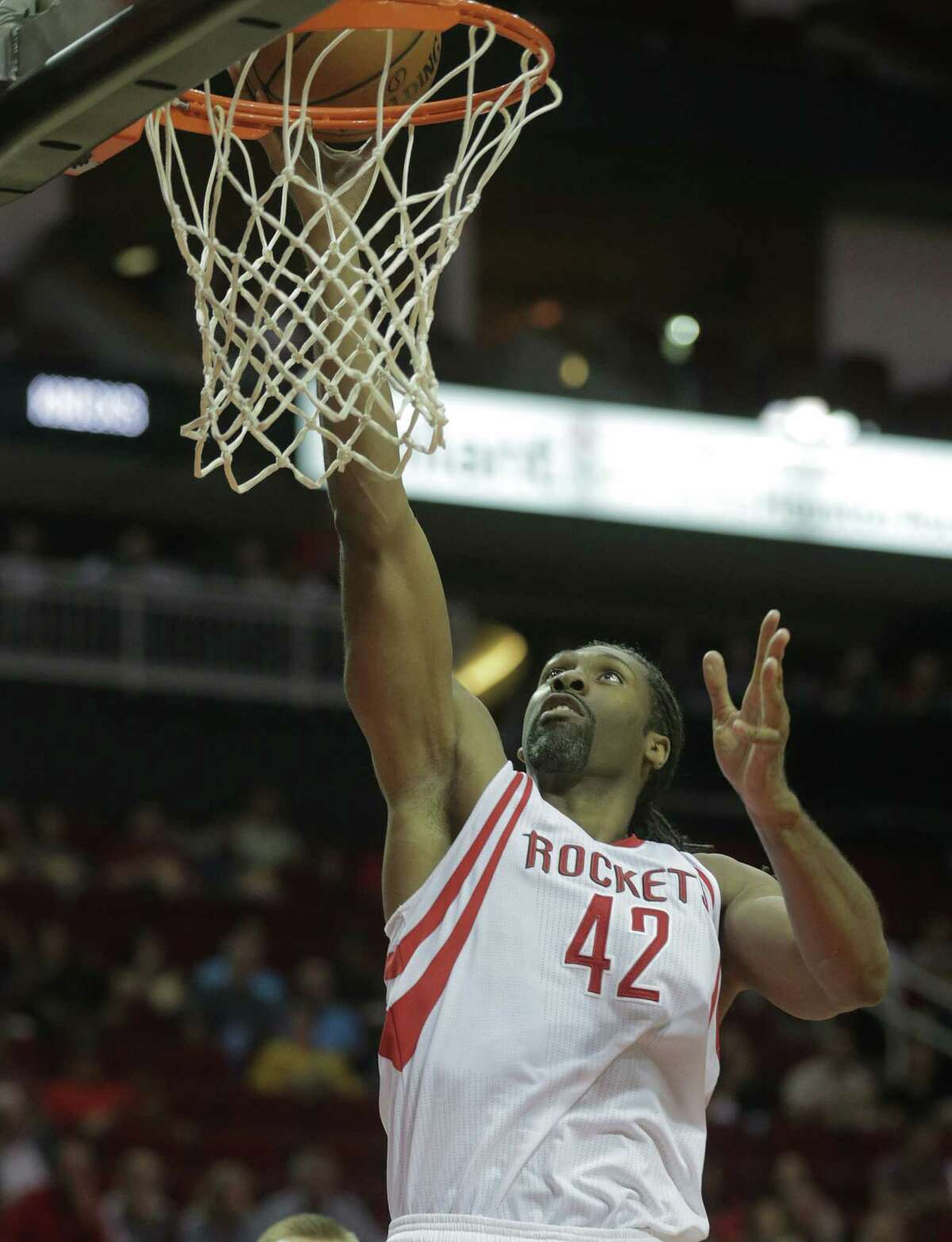 Houston Rockets center Nene Hilario (42) puts up two in the first half against New York Knicks at the Toyota Center on Tuesday, Oct. 4, 2016, in Houston.