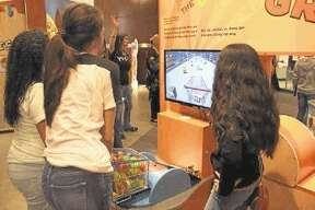 STEM Program students learn on an interactive exhibit in the MyPlate and Beyond nutritional exhibit.