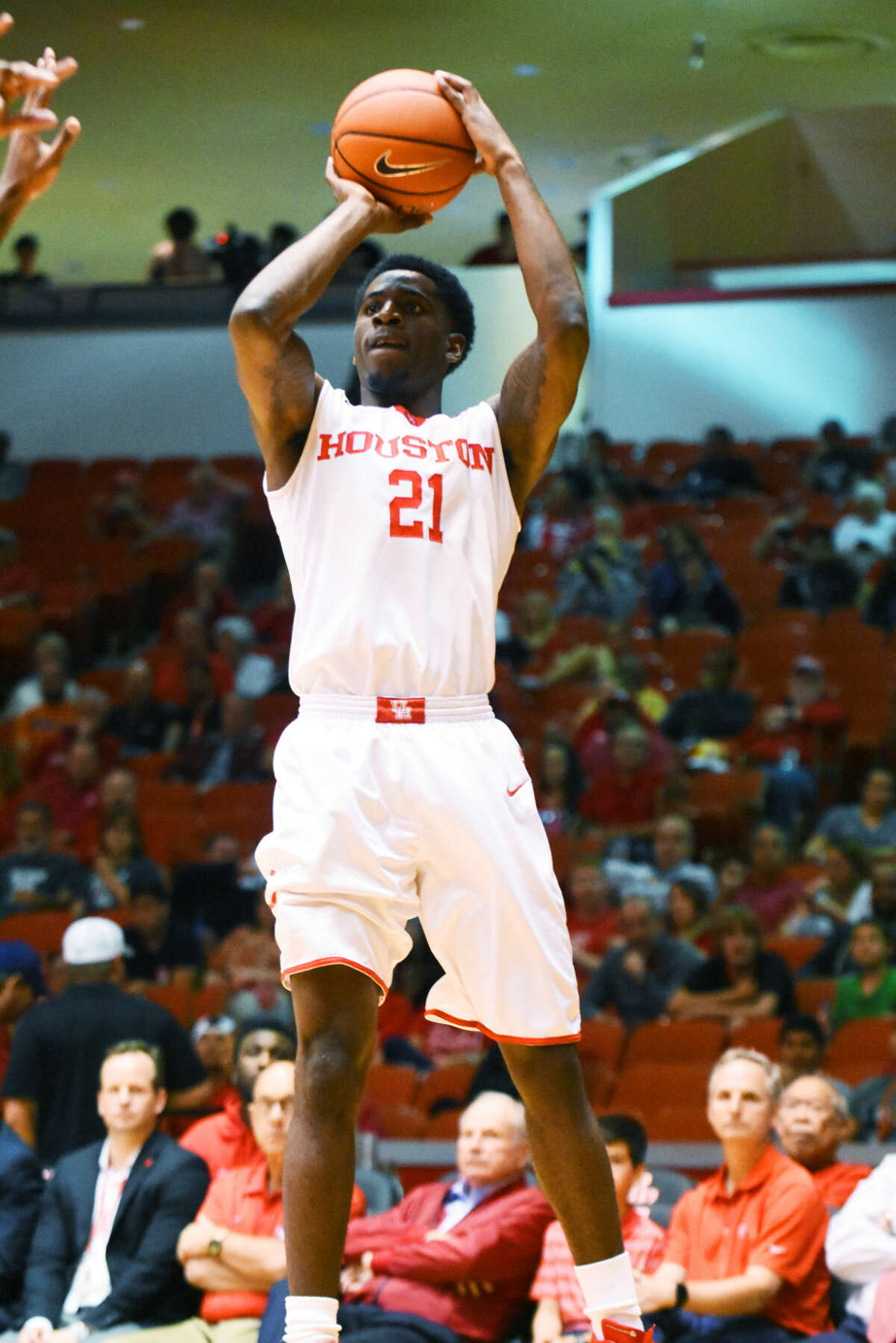 University of Houston junior guard Damyean Dotson rises for a three-point shot against Cincinnati Thursday, March 3, at Hofheinz Pavilion. Dotson scored 13 points and grabbed a team-high seven rebounds in the 69-56 victory.