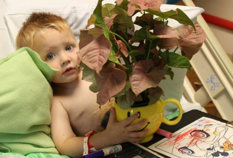 This week, hospital patients, such as 23-month-old Hunter Green at Children's Memorial Hermann Hospital, received an unexpected gift to brighten their day - a bouquet of flowers from Teleflora.