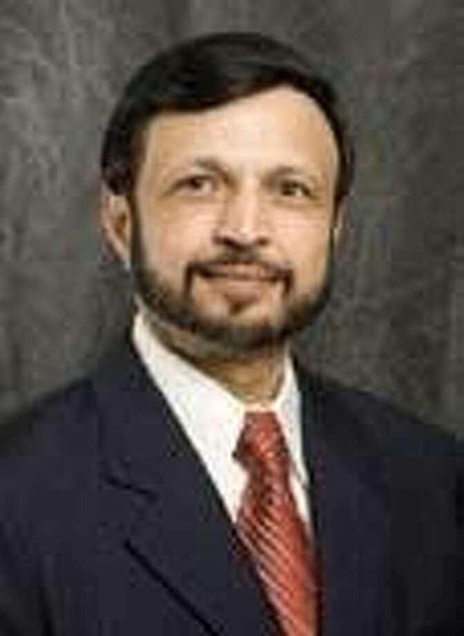 Dr. Parendra Banker