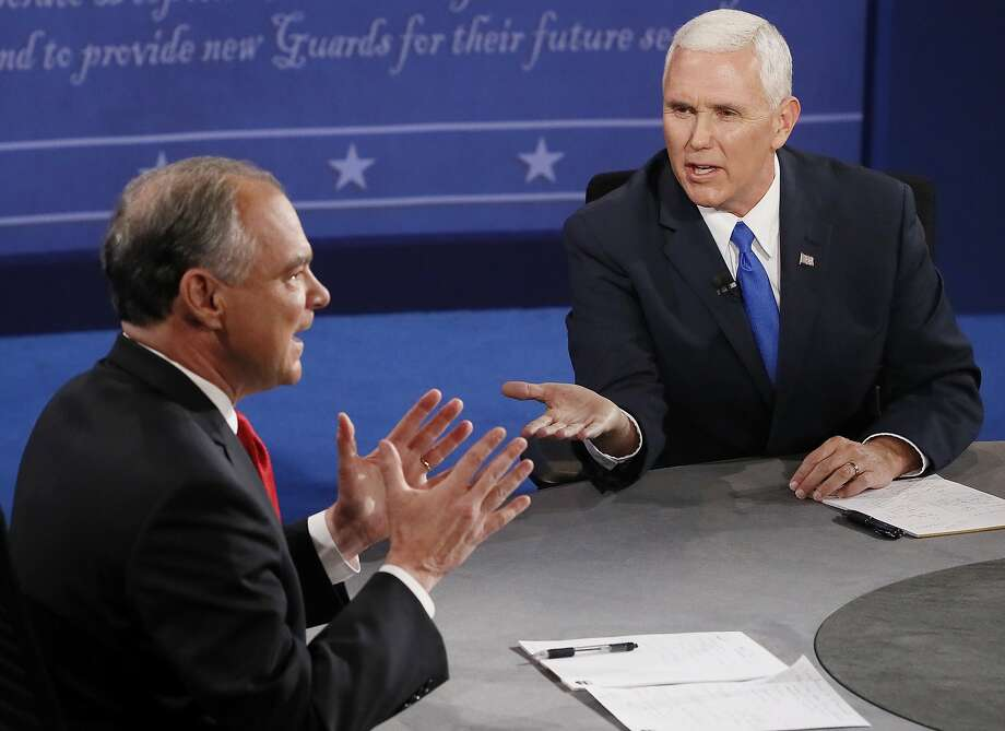 Republican vice-presidential nominee Gov. Mike Pence, right, and Democratic vice-presidential nominee Sen. Tim Kaine speak during the vice-presidential debate at Longwood University in Farmville, Va., Tuesday, Oct. 4, 2016. (Andrew Gombert/Pool via AP) Photo: Andrew Gombert, Associated Press
