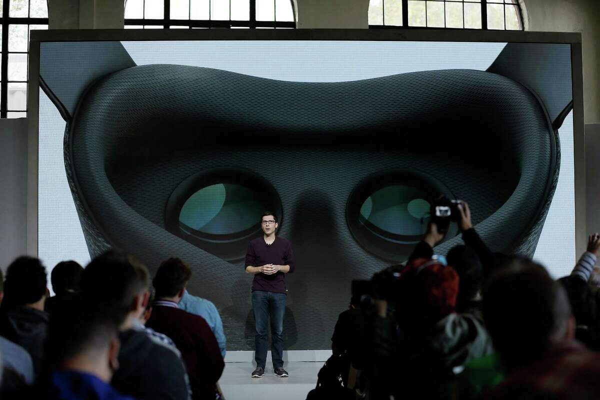 Clay Bavor, Google vice president of virtual reality, talks about the Daydream View virtual-reality headset during a product event, Tuesday, Oct. 4, 2016, in San Francisco. It will differ from other headsets like Samsung's Gear VR in having a companion motion controller and compatibility with a wide range of phones, including Google's new Pixel phones. (AP Photo/Eric Risberg)