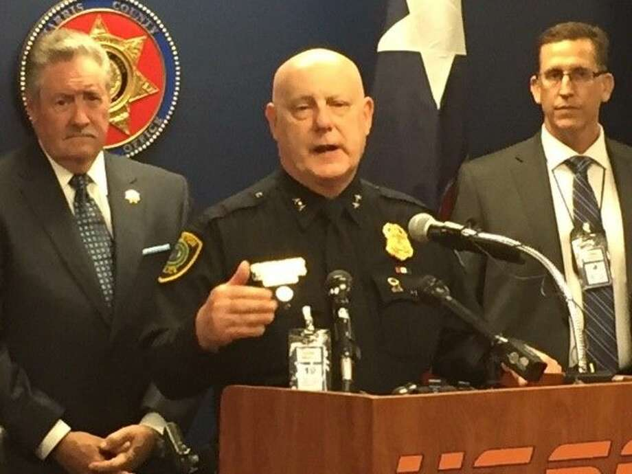 Harris County Sheriff Ron Hickman (l) and HPD's Capt. Dan Harris (r) flank HPD Assistant Chief Mark Curran as he addresses the media after announcing the arrest of more than 400 'johns' in a joint task force sting. The two-month initiative continues.