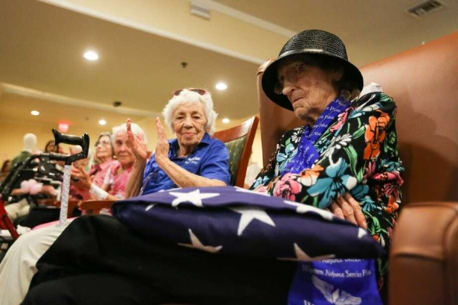Mayme Lee Knight Tanner, a Women Airforce Service Pilot from World War II, accepts a U.S. flag to commemorate her 100th birthday celebration on July 25 at Silverado Senior Living in Houston. Photo: Michael Minasi