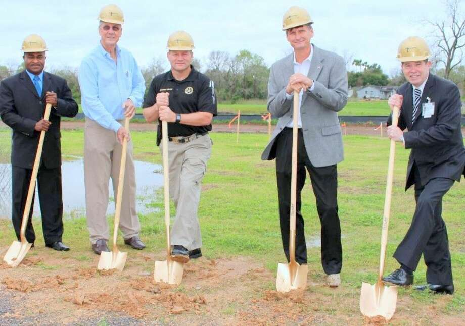 Participating in the ground-breaking ceremony were, from left, Richard Erivo, inmates vocational administrator for the Sheriff's Office,, Precinct 4 Commissioner James Patterson, Sheriff Troy E. Nehls, James Knight, facilities director for Fort Bend County and Major Thomas Goodfellow, the detention bureau commander at the Sheriff's Office.