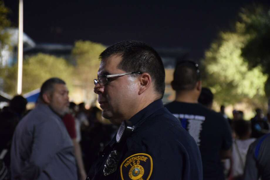 North side ISD police officer Zachary Castillo at John Jay High School's National Night Out on Tuesday.  Photo: Silvia Foster-Frau