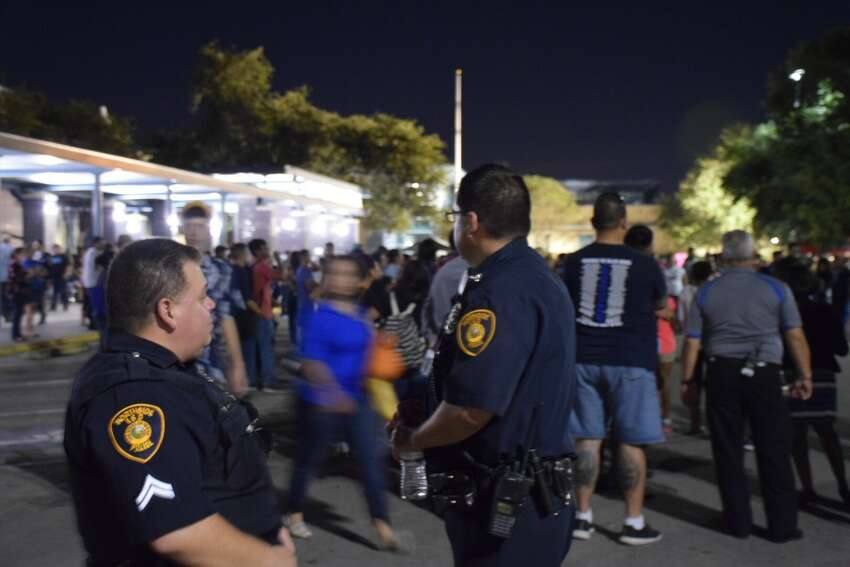 From left to right NISD officers Rick Mendoza and Zachary Castillo at John Jay High School's National Night Out on Tuesday.