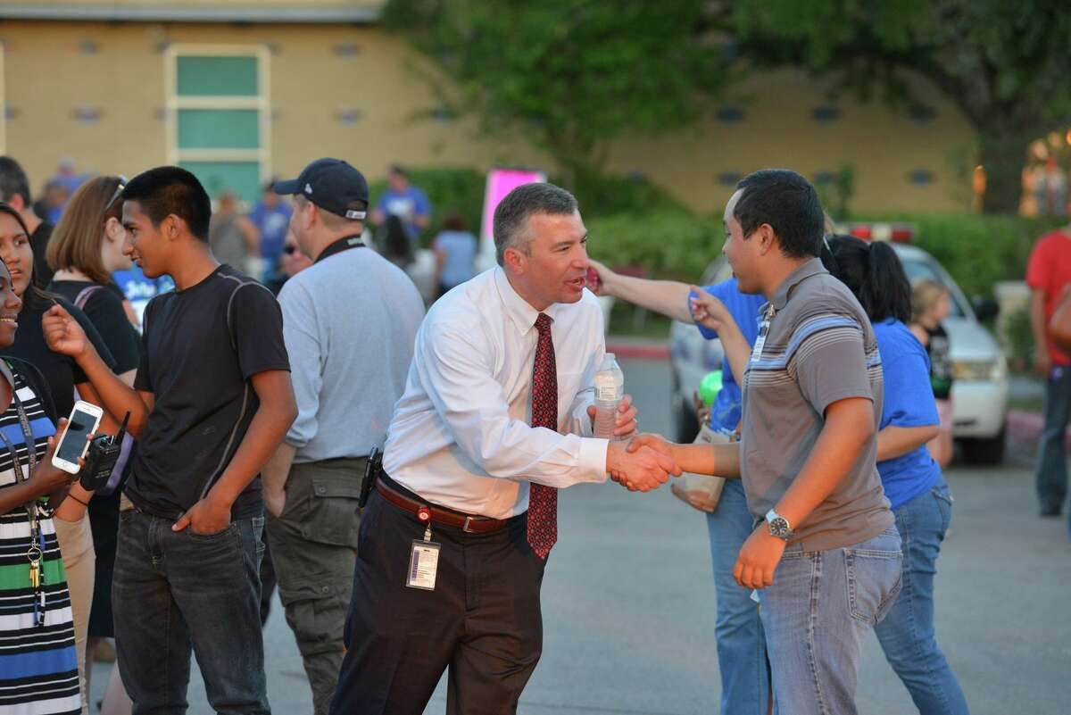 Northside ISD Superintendent Brian Woods greets attendees during aNational Night Out event at Jay High School in 2016.