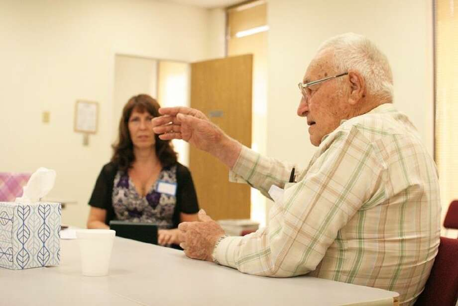 World War II veteran Elmer Lee shares his experiences about serving in the Pacific while ACC Court Reporting student Amy Quincey takes down his comments on July 19. Photo: Courtesy ACC